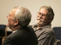 An unrepentant Jim Adkisson, right, shares a laugh with his lawyer Mark Stephens during Adkisson's court proceedings.