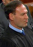 Supreme Court Justice Samuel Alito listens to President Obama's State of the Union address.