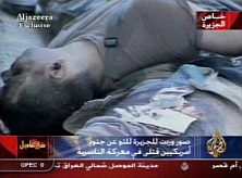 A photo of a slain US soldier as broadcast on Al Jazeera.
