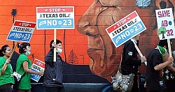 Protesters in Los Angeles demonstrate against Proposition 23 outside a Tesoro refinery in Wilmington, California.