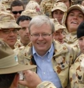 Australian troops at Camp Terendak crowd around newly elected Prime Minister Kevin Rudd during his December 2007 visit to the camp.