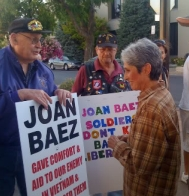 Folk singer Joan Baez discusses health care reform with a reform opponent.