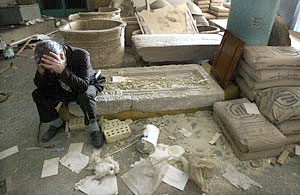 Deputy curator Mohsen Hassan sits amidst the wreckage in the National Museum.
