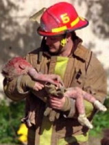 Firefighter Chris Fields carries a mortally wounded child, Baylee Almon, from the wreckage of the Murrah Building on April 19. The child dies in the ambulance. The photograph, by Charles H. Porter IV, wins a Pulitzer Prize and becomes one of the iconic images of the bombing.