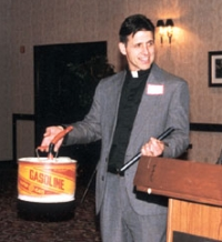 In January 2001, Michael Bray poses with the 'Gas Can' Award given to him by the Army of God for his advocacy of violence against abortion clinics.