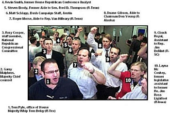 A photograph of the Republican operatives mobbing the Miami-Dade elections offices. Those identified in the photograph include Thomas Pyle, Garry Malphrus, Rory Cooper, Kevin Smith, Steven Brady, Matt Schlapp, Roger Morse, Duane Gibson, Chuck Royal, and Layna McConkey.