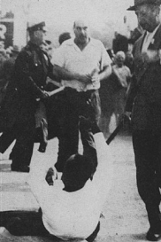 Eugene Bullard being beaten by police officers and rioters.