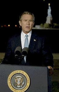 Bush giving his speech in front of the Statue of Liberty.
