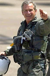 Bush, wearing his flight suit, before giving the 'Mission Accomplished' speech.