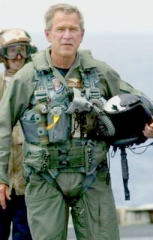 Bush wearing his flight suit. The equipment below his belt is a portion of his parachute harness, which is normally removed upon landing.