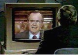 Dan Rather interviews Vice President Bush, watching him on a monitor. Neither Rather nor the CBS viewers can see Bush's consultant Roger Ailes off-camera.