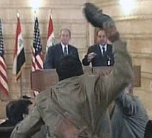 An Iraqi journalist hurls a shoe at President Bush.