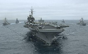A carrier group steams toward its destination.