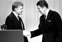 President Carter and Ronald Reagan shake hands during the 1980 presidential debate.