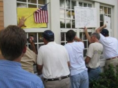 Protesters bang on the windows of the Children's Board, demanding to be heard.