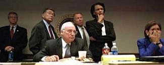 Dick Cheney and senior staff witness the collapse of the WTC South Tower. Directly behind Cheney are Norman Mineta and I. Lewis &#8216;Scooter&#8217; Libby. National Security Advisor Condoleezza Rice stands behind Cheney&#8217;s left shoulder.