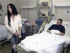 Cher talks with a wounded soldier at Landstuhl Medical Center in Germany.