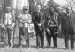 President Calvin Coolidge stands with four Osage Indians after he signs the Indian Citizenship Act into law.