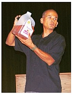 Rod Coronado displays a jug of gasoline and oil that can be used as an incendiary device.