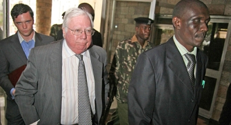 Jerome Corsi leaving Kenya, with members of his entourage and Kenyan escorts.