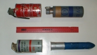 A variety of military-grade CS gas canisters. A ruler lies between them as a size reference. It is unclear if the FBI plans to use canisters similar to these in the Davidian assault.