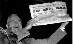 President Harry Truman triumphantly displays a newspaper headline declaring victory for his opponent, Thomas Dewey. Dewey lost the election.