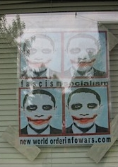 "The poster featured in the front window of the Drop Zone. The caption reads: ""Fascism. Socialism. New World Order. InfoWars.com."""