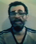 Blurry photo, taken from a television broadcast, of US hostage Edward Tracy.