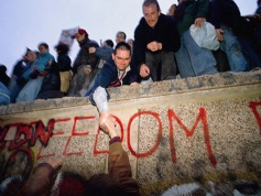 West and East Germans come together as the Berlin Wall is torn down.