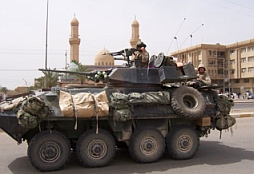A Marine armored personnel carrier pulls out of Fallujah.