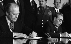 President Ford and Soviet General Secretary Leonid Brezhnev sign a communique relating to the SALT negotiations in November 1974.