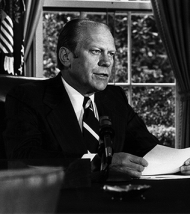 Ford delivering the televised address in which he announces the pardon of Nixon.