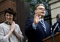 Senator-elect Al Franken (D-MN) acknowledges his victory in front of his Minneapolis home. His wife Franni Franken looks on.