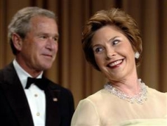 President and Mrs. Bush enjoy a laugh at the Correspondents' Dinner.