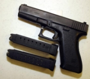 A Glock 9mm pistol similar to the one carried by Timothy McVeigh, with two ammunition clips.