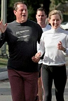 In an attempt to appear nonchalant for the press, Al Gore goes jogging with his daughter Karenna and with members of the press filming the proceedings.