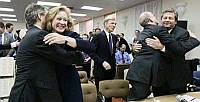 Lawyers for the Washington Democratic Party celebrate after the court ruling certifying Christine Gregoire as governor.