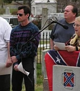 A photograph of Doug Hanks (left) attending a March 2005 protest of the removal of the Confederate Battle Flag in Charlotte.