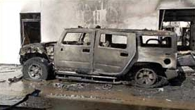 A burned Hummer at the vandalized West Covina dealership.