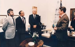 Reagan meets with Contra leaders in the Oval Office. NSC staffer and Contra &#8220;handler&#8221; Oliver North is at the far right; when this photo is released to the public, North will be cropped out.