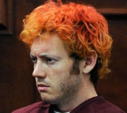 Accused Aurora gunman James Holmes looks on during a recent court hearing regarding his alleged crimes. At some point, Holmes dyed his hair, allegedly to more closely resemble 'The Joker,' a villain in the Batman movies.