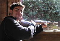 Joaquin Serrapio posing with one of his pellet guns. 