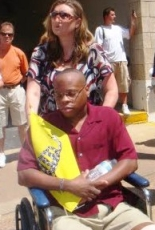 Kenneth Gladney being wheeled around a protest in Mehlman, Missouri.