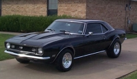 A 1968 black Camaro virtually identical to the one destroyed by the FBI. In later years, the model will be sold as &#8216;David Koresh&#8217;s Camaro.&#8217;