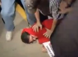 A protester outside a Kentucky Senate campaign event is thrown to the ground and stomped by the candidate's supporters.