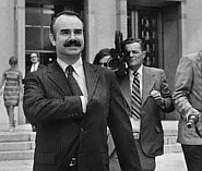 A confident G. Gordon Liddy leaves the courtroom.
