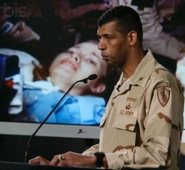 General Vincent Brooks briefing reporters, with a photograph of Jessica Lynch displayed in the background.