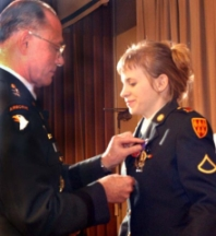 Jessica Lynch receives one of three medals awarded to her for her service in Iraq.