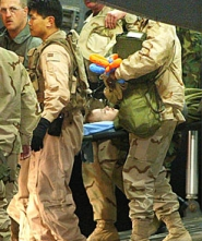 Jessica Lynch being carried from a transport plane to a hospital in Ramstein, Germany, April 2, 2003.