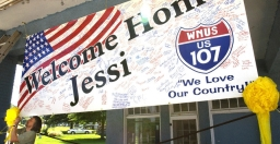 A banner welcoming Jessica Lynch home.